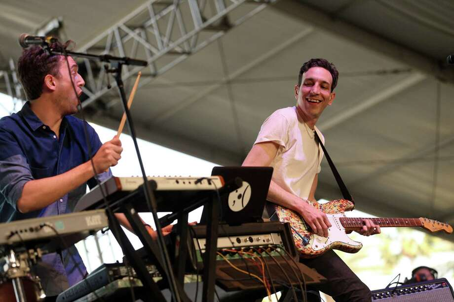 Musicians Jesse Cohen and Eric Emm of Tanlines perform onstage during day 3 of the 2013 Coachella Valley Music & Arts Festival at the Empire Polo Club on April 14, 2013 in Indio, California. Photo: Karl Walter, Getty Images / 2013 Getty Images