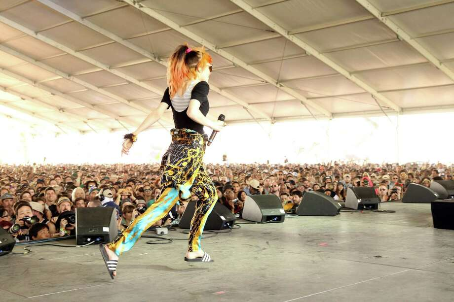 Musician Grimes performs onstage during day 3 of the 2013 Coachella Valley Music & Arts Festival at the Empire Polo Club on April 14, 2013 in Indio, California. Photo: Karl Walter, Getty Images / 2013 Getty Images