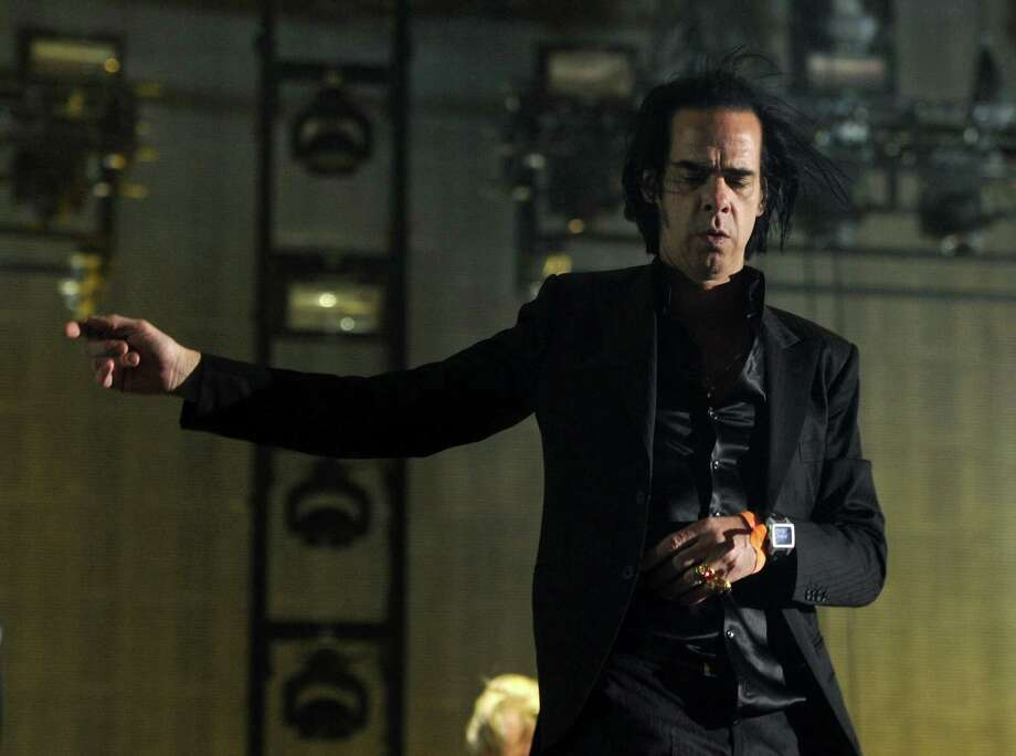 Musician Nick Cave of the band Nick Cave and the Bad Seeds performs onstage during day 3 of the 2013 Coachella Valley Music & Arts Festival at the Empire Polo Club on April 14, 2013 in Indio, California. Photo: Kevin Winter, Getty Images / 2013 Getty Images