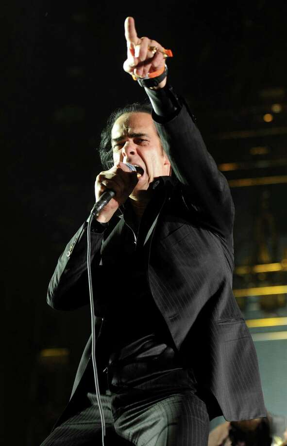 Musician Nick Cave of the band Nick Cave and the Bad Seeds perform onstage during day 3 of the 2013 Coachella Valley Music & Arts Festival at the Empire Polo Club on April 14, 2013 in Indio, California. Photo: Kevin Winter, Getty Images / 2013 Getty Images