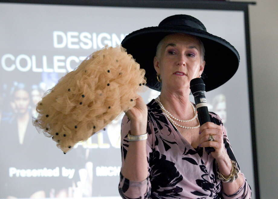 Heloise shows off one of her mother's hats during her introduction of Express-News Senior Fashion Writer Michael Quintanilla at Quintanilla's induction as the first male member of the Woman's Club of San Antonio.  Photo: Jamie Couch Karutz, SPECIAL TO THE EXPRESS-NEWS / Copyright: Jamie Karutz All Rights Reserved