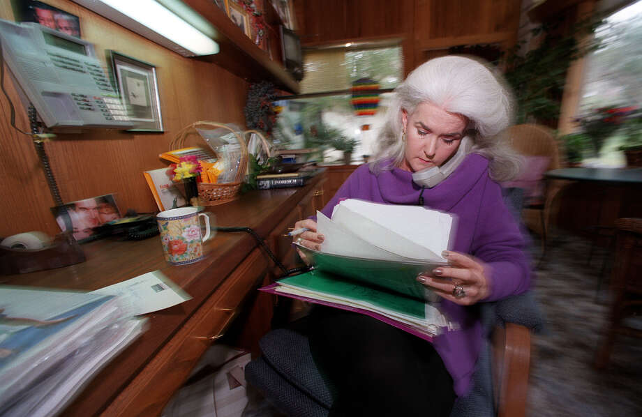 Heloise takes care of business matters over the phone in her home office in San Antonio. Photo: Gloria Ferniz, SAN ANTONIO EXPRESS-NEWS / SAN ANTONIO EXPRESS-NEWS