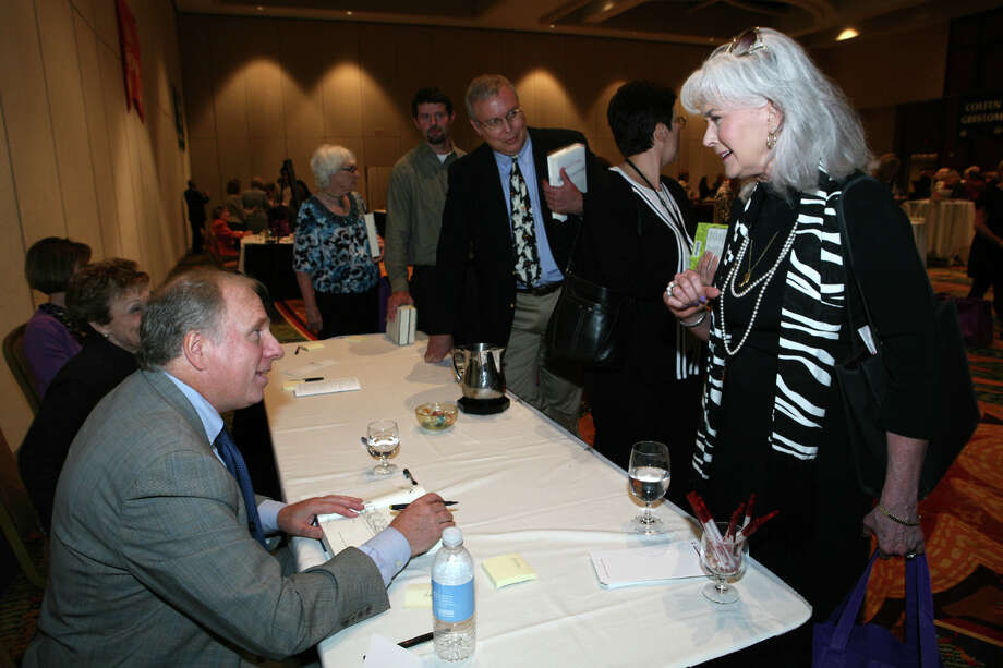Ian Frazier (Author) signs a book for Heloise at the Book and Author Luncheon on 10/18/2010 at the Marriott Rivercenter Hotel.  Photo: LELAND A. OUTZ, SPECIAL TO THE EXPRESS-NEWS / SAN ANTONIO EXPRESS-NEWS
