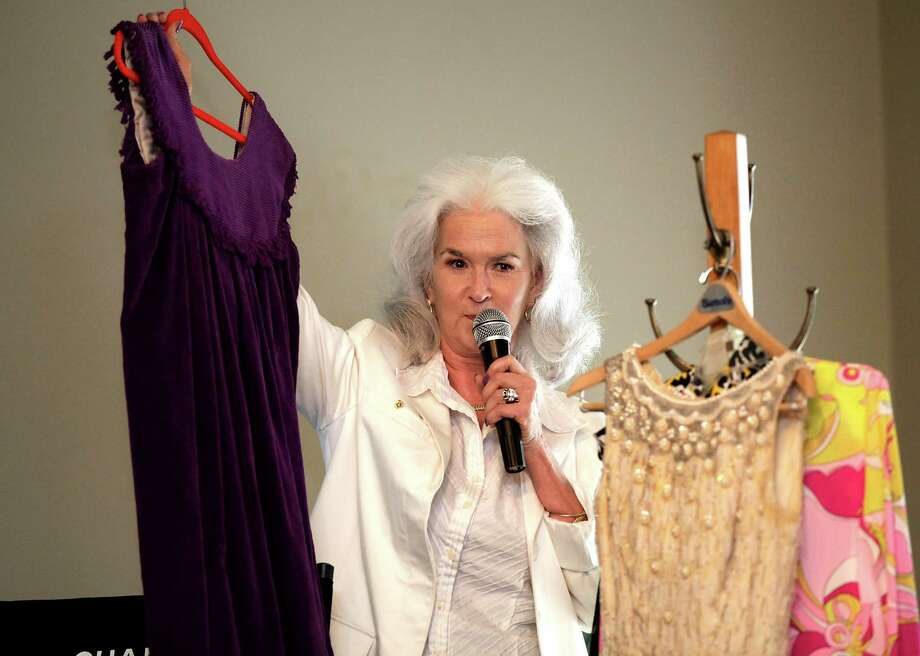 Heloise shows dresses owned by her mother as she speaks to the Woman's Club of San Antonio, Aug. 17, 2011.  Photo: BOB OWEN, SAN ANTONIO EXPRESS-NEWS / rowen@express-news.net