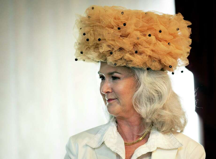 Heloise wears a hat owned by her mother as she speaks to the Woman's Club of San Antonio, Aug. 17, 2011.  Photo: BOB OWEN, SAN ANTONIO EXPRESS-NEWS / rowen@express-news.net