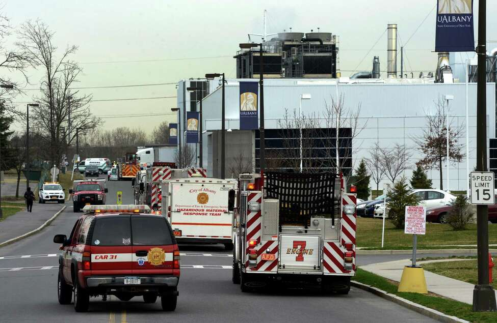 Albany Fire Department apparatus lines the roads leading to the Albany Nano Tech center at the University at Albany Monday morning April 15, 2013, in Albany, N.Y. where a hydrogen sulfide leak occurred. (Skip Dickstein/Times Union)