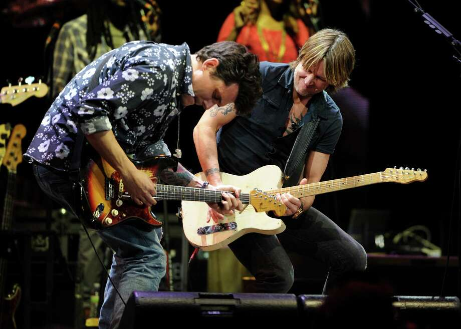 Musicians John Mayer, left, and Keith Urban perform together at Eric Clapton's Crossroads Guitar Festival 2013 at Madison Square Garden on Friday April 12, 2013 in New York. (Photo by Evan Agostini/Invision for Hard Rock International/AP Images) Photo: Evan Agostini, Evan Agostini/Invision/AP / Invision