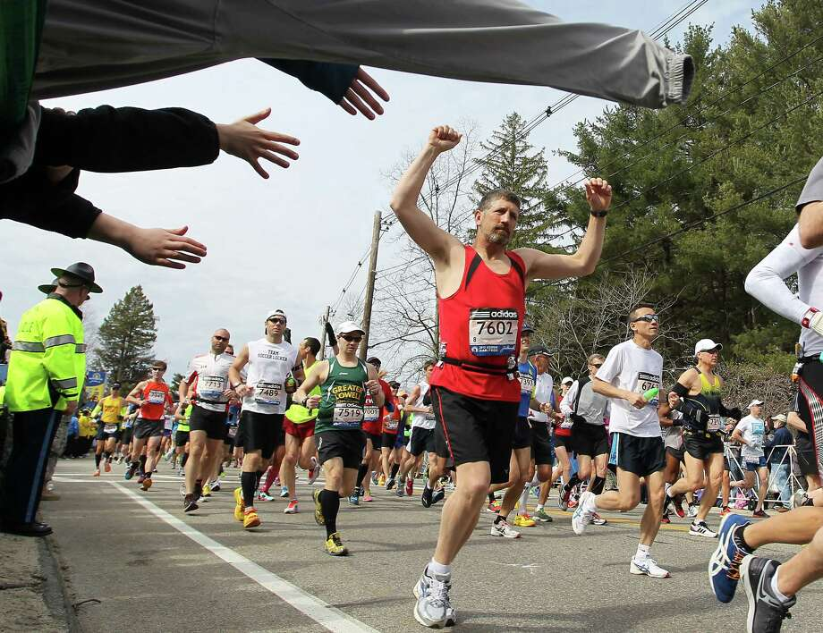 Chris Royer, from Coventry, Vt., raises his hands as he starts of the 117th running of the Boston Marathon, in Hopkinton, Mass., Monday, April 15, 2013. (AP Photo/Stew Milne) Photo: Associated Press