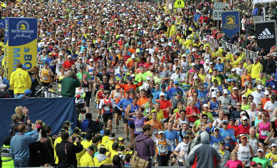 Runners start the 117th running of the Boston Marathon, in Hopkinton, Mass., Monday, April 15, 2013. (AP Photo/Stew Milne) Photo: Associated Press