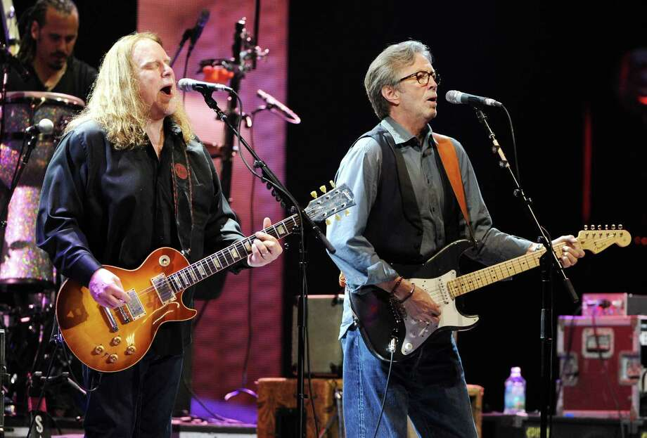Musician Eric Clapton, right, joins Warren Haynes and The Allman Brothers Band on stage at Eric Clapton's Crossroads Guitar Festival 2013 at Madison Square Garden on Friday April 12, 2013 in New York. (Photo by Evan Agostini/Invision for Hard Rock International/AP Images) Photo: Evan Agostini, Evan Agostini/Invision/AP / Invision