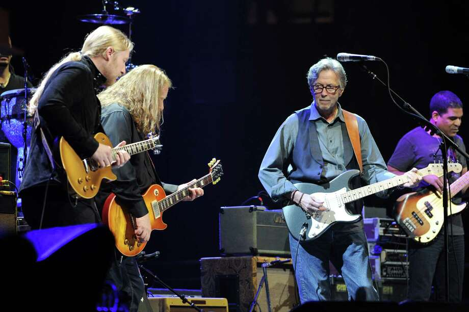 Musician Eric Clapton, right, joins Derek Trucks and Warren Haynes, center, of The Allman Brothers Band on stage at Eric Clapton's Crossroads Guitar Festival 2013 at Madison Square Garden on Friday April 12, 2013 in New York. (Photo by Evan Agostini/Invision for Hard Rock International/AP Images) Photo: Evan Agostini, Evan Agostini/Invision/AP / Invision