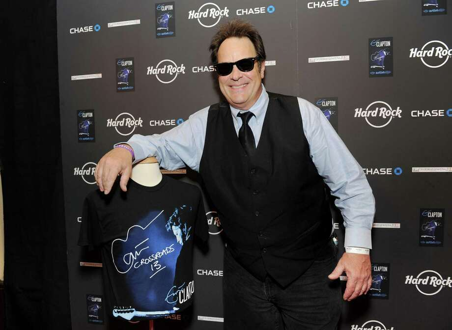 IMAGE DISTRIBUTED FOR HARD ROCK INTERNATIONAL - Actor and musician Dan Aykroyd poses with Hard Rock's new limited edition Eric Clapton Artist Spotlight T-Shirt at Eric Clapton's Crossroads Guitar Festival artist party at The Hard Rock Cafe New York on Thursday, April 11, 2013 in New York City, New York. Photo: Evan Agostini, Invision For Hard Rock Internati / Invision
