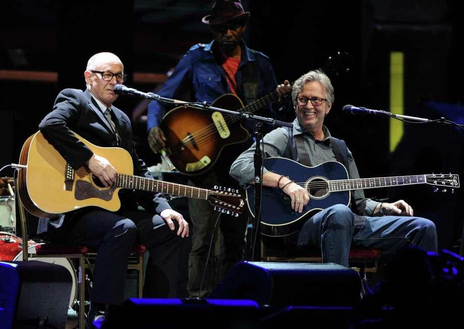 Musicians Eric Clapton, right, and Andy Fairweather-Low perform together at Eric Clapton's Crossroads Guitar Festival 2013 at Madison Square Garden on Friday April 12, 2013 in New York. (Photo by Evan Agostini/Invision for Hard Rock International/AP Images) Photo: Evan Agostini, Evan Agostini/Invision/AP / Invision