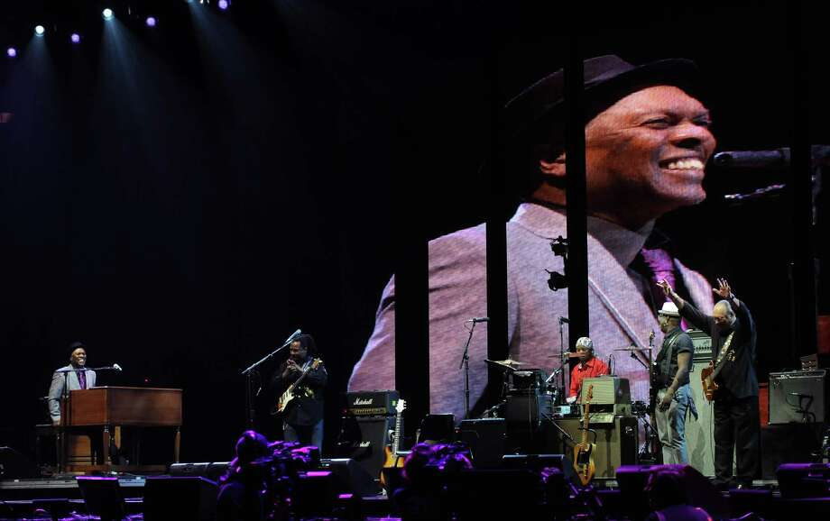 Musician Booker T. Jones, left, and band with Steve Kropper, right, on guitar, perform at Eric Clapton's Crossroads Guitar Festival 2013 at Madison Square Garden on Friday April 12, 2013 in New York. (Photo by Evan Agostini/Invision for Hard Rock International/AP Images) Photo: Evan Agostini, Evan Agostini/Invision/AP / Invision