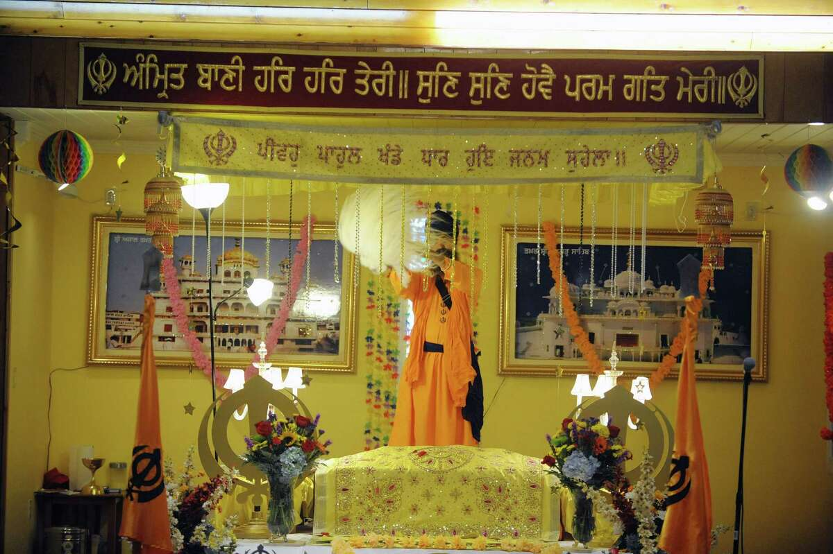 Temple member, Gurmail Singh stands behind the alter where the Guru Granth Sahib (hold book) is covered to show his respect during a celebration of Vaisakhi Gurpurab at the Niskayuna Gurdwara Sahib temple on Sunday, April 14, 2013 in Niskayuna, NY. The three day event celebrates the gathering of the sangat for Vaisakhi at Sri Anandpur Sahib Ji in 1699, that produced a fundamentally important spiritual event in Sikh history. The temple which is in its second year, held events from Friday through Sunday. Political leaders along with members of law enforcement were also on hand on Sunday to be honored and to talk to members of the community. About 150 families belong to the temple. (Paul Buckowski / Times Union)