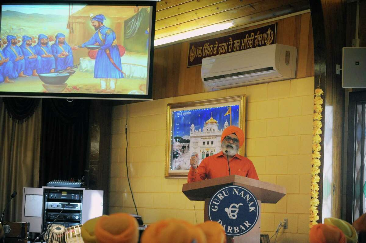 Paul Singh, secretary fo the temple, talks about the history of his religion during a celebration of Vaisakhi Gurpurab at the Niskayuna Gurdwara Sahib temple on Sunday, April 14, 2013 in Niskayuna, NY. The three day event celebrates the gathering of the sangat for Vaisakhi at Sri Anandpur Sahib Ji in 1699, that produced a fundamentally important spiritual event in Sikh history. The temple which is in its second year, held events from Friday through Sunday. Political leaders along with members of law enforcement were also on hand on Sunday to be honored and to talk to members of the community. About 150 families belong to the temple. (Paul Buckowski / Times Union)