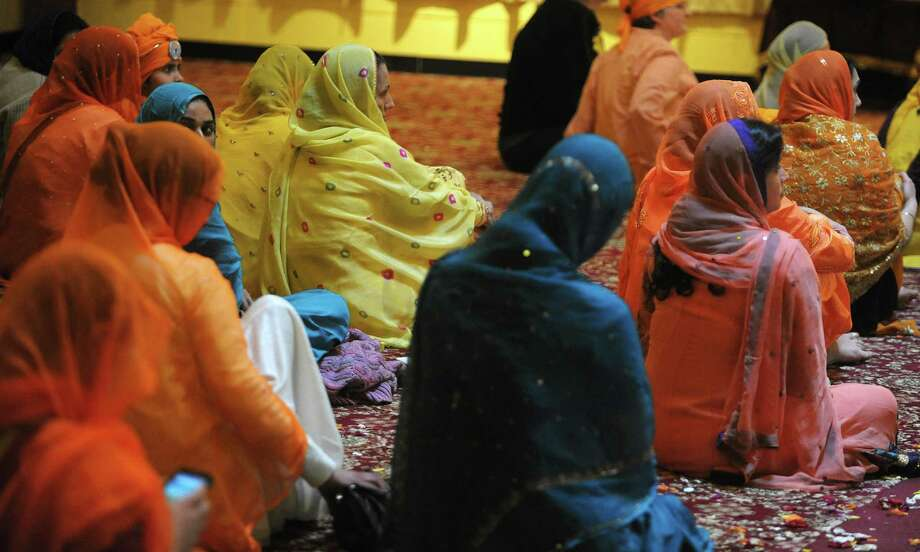 Women sit inside the temple as they listen to speakers during a celebration of Vaisakhi Gurpurab at the Niskayuna Gurdwara Sahib temple on Sunday, April 14, 2013 in Niskayuna, NY. The three day event celebrates the gathering of the sangat for Vaisakhi at Sri Anandpur Sahib Ji in 1699, that produced a fundamentally important spiritual event in Sikh history.  The temple which is in its second year, held events from Friday through Sunday.  Political leaders along with members of law enforcement were also on hand on Sunday to be honored and to talk to members of the community.  About 150 families belong to the temple.    (Paul Buckowski / Times Union) Photo: Paul Buckowski