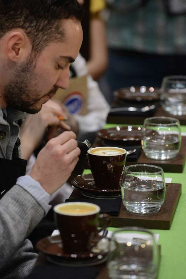 BOSTON - APRIL 13: Judges test coffee during the U.S. Barista Championships at the Coffee Industry Expo at the Boston Convention and Exhibition Center April 13, 2013 in Boston, Massachusetts. Fifty of the county's best baristas got 15 minutes to prepare and serve four espressos, four cappuccinos and four signature beverages to a panel of judges. The annual event brings in thousands of coffee lovers from around the country. Photo: Darren McCollester, Getty Images / 2013 Getty Images