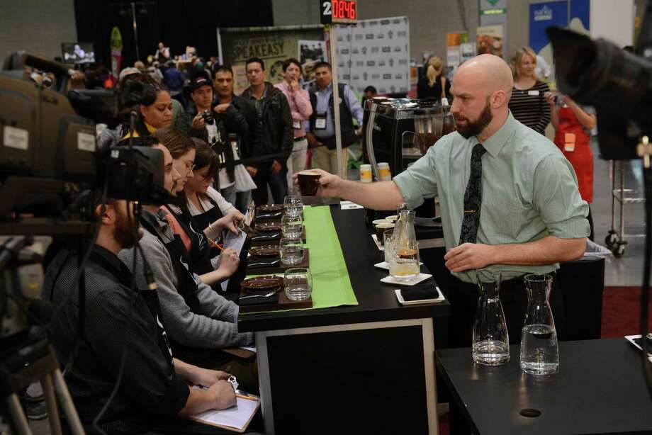 BOSTON - APRIL 13: Barista Pete Licata, of Parisi Coffee, competes in the U.S. Barista Championships during the Coffee Industry Expo at the Boston Convention and Exhibition Center April 13, 2013 in Boston, Massachusetts. Fifty of the county's best baristas got 15 minutes to prepare and serve four espressos, four cappuccinos and four signature beverages to a panel of judges. The annual event brings in thousands of coffee lovers from around the country. Photo: Darren McCollester, Getty Images / 2013 Getty Images