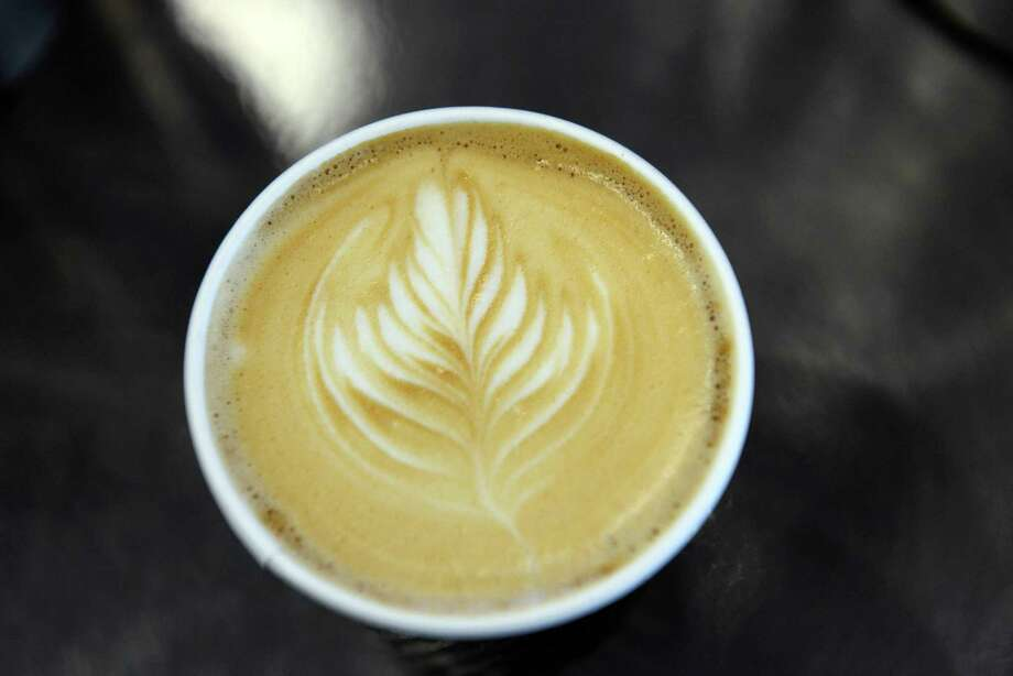 BOSTON - APRIL 13: A cafe latte is seen during the Coffee Industry Expo at the Boston Convention and Exhibition Center April 13, 2013 in Boston, Massachusetts. Coffee vendors and lovers converged on Boston to see the newest advances in the industry, taste coffees from around the world, and to watch the U.S. Barista Championships. Photo: Darren McCollester, Getty Images / 2013 Getty Images