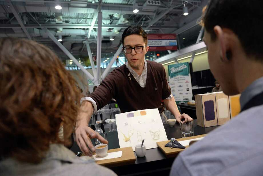 BOSTON - APRIL 13:  Barista Charles Babinski, of G & B Coffee competes in the U.S. Barista Championships during the Coffee Industry Expo at the Boston Convention and Exhibition Center April 13, 2013 in Boston, Massachusetts. Fifty of the county's best baristas got 15 minutes to prepare and serve four espressos, four cappuccinos and four signature beverages of their choice to a panel of judges. The annual event brings in thousands of coffee lovers from around the country. Photo: Darren McCollester, Getty Images / 2013 Getty Images