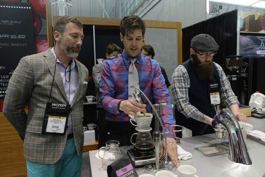 BOSTON - APRIL 13: Vendors attend the Coffee Industry Expo at the Boston Convention and Exhibition Center April 13, 2013 in Boston, Massachusetts. Coffee vendors and lovers converged on Boston to see the newest advances in the industry, taste coffees from around the world, and to watch the U.S. Barista Championships. Photo: Darren McCollester, Getty Images / 2013 Getty Images