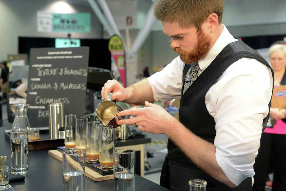 BOSTON - APRIL 13: Barista Josh Taves, of Dogwood Coffee, competes in the U.S. Barista Championships during the Coffee Industry Expo at the Boston Convention and Exhibition Center April 13, 2013 in Boston, Massachusetts. Fifty of the county's best baristas got 15 minutes to prepare and serve four espressos, four cappuccinos and four signature beverages to a panel of judges. The annual event brings in thousands of coffee lovers from around the country. Photo: Darren McCollester, Getty Images / 2013 Getty Images