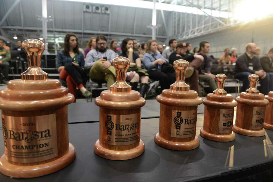 BOSTON - APRIL 13: Spectators take in the U.S. Barista Championships during the Coffee Industry Expo at the Boston Convention and Exhibition Center April 13, 2013 in Boston, Massachusetts. Fifty of the county's best baristas got 15 minutes to prepare and serve four espressos, four cappuccinos and four signature beverages to a panel of judges. The annual event brings in thousands of coffee lovers from around the country. Photo: Darren McCollester, Getty Images / 2013 Getty Images