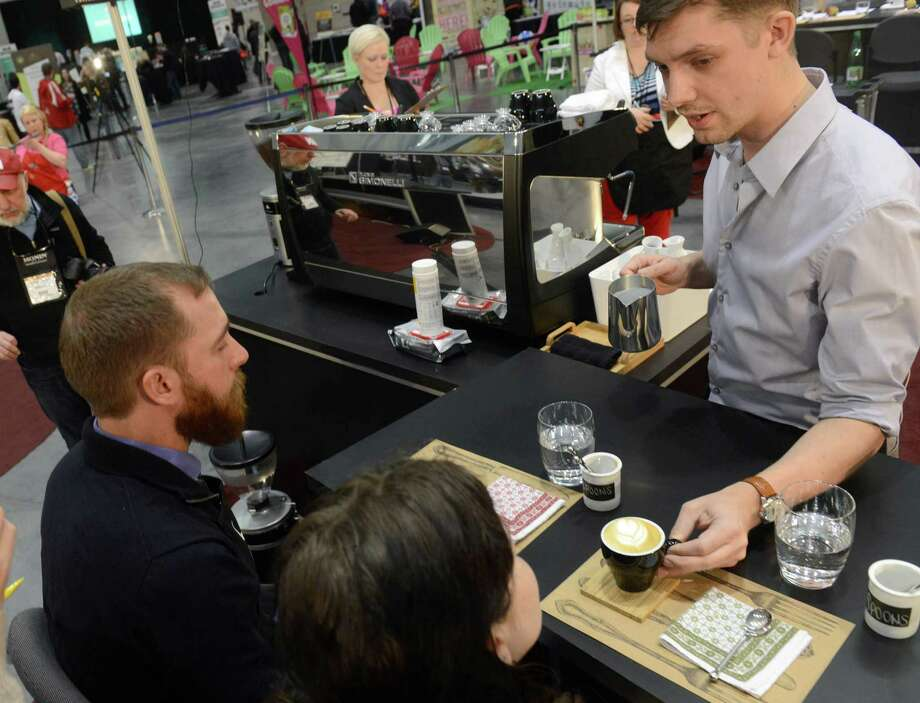 BOSTON - APRIL 13: Barista Travis Beckett, of Peregrine Express, competes in the U.S. Barista Championships during the Coffee Industry Expo at the Boston Convention and Exhibition Center April 13, 2013 in Boston, Massachusetts. Fifty of the county's best baristas got 15 minutes to prepare and serve four espressos, four cappuccinos and four signature beverages to a panel of judges. The annual event brings in thousands of coffee lovers from around the country. Photo: Darren McCollester, Getty Images / 2013 Getty Images