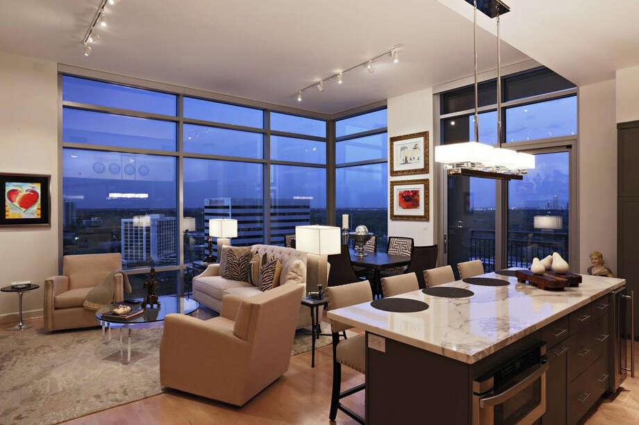 This penthouse suite offers gorgeous views of downtown Houston. It'll cost you just over a million though.Database:Search for your neighborhood Photo: Heritage Texas Properties