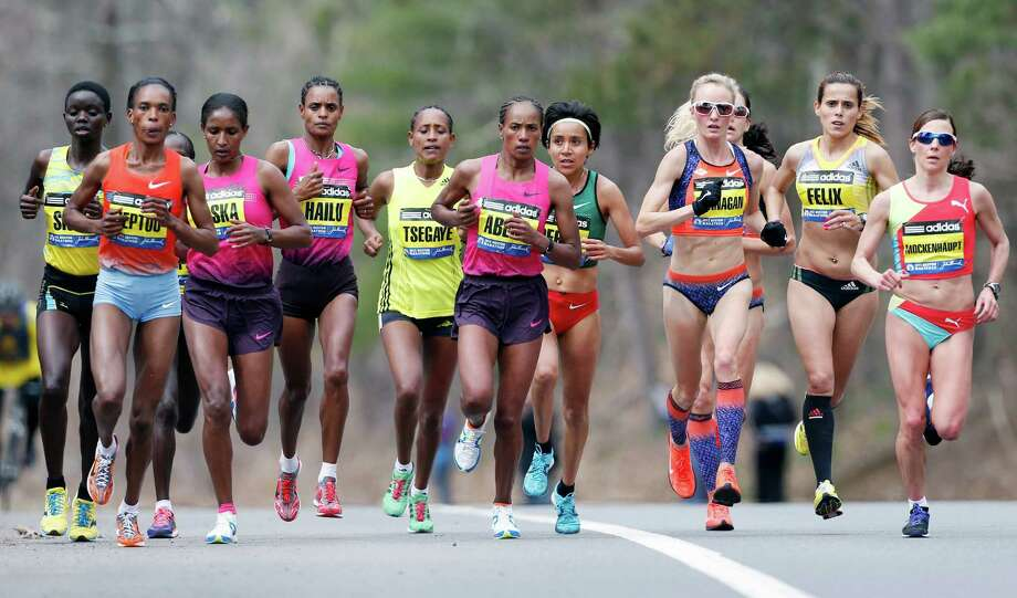 Elite female marathoners, front row from left, Rita Jeptoo, Mamitu Daska, Meserat Debele, Tirifi Beyene, Alemitu Begna, Shalane Flanagan, Ana Felix and Sabrina Mockenhaupt compete on the course in Wellesley, Mass., Monday, April 15, 2013. (AP Photo/Michael Dwyer) Photo: Associated Press