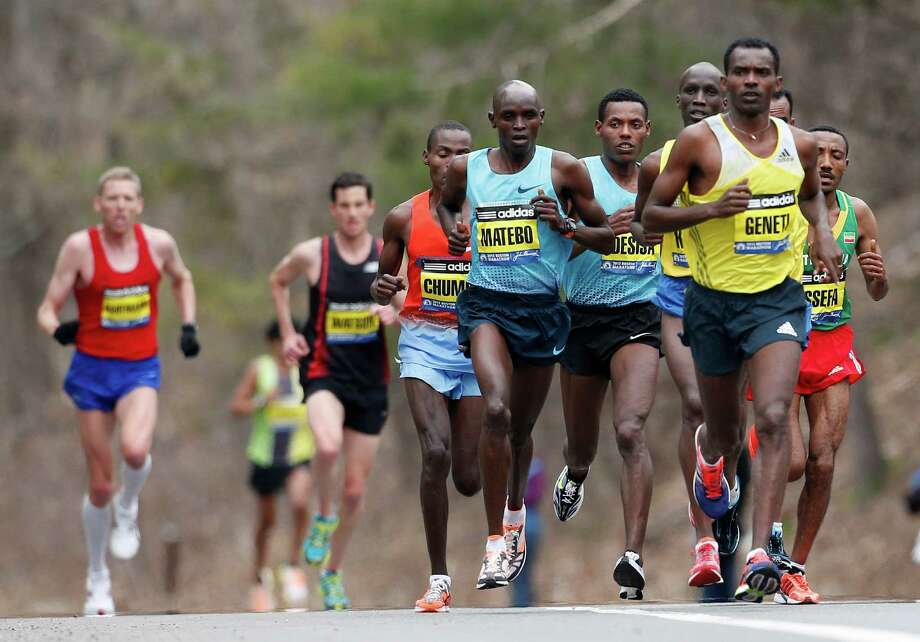 Elite mens marathoners including Levy Matebo, fourth from left, and Markos Geneti, front right, run in the 117th Boston Marathon in Wellesley, Mass., Monday, April 15, 2013. (AP Photo/Michael Dwyer) Photo: Associated Press
