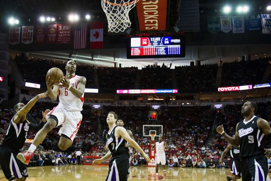 April 14: Rockets 121, Kings 100  Rockets power forward Terrence Jones drives to the basket against the Kings.