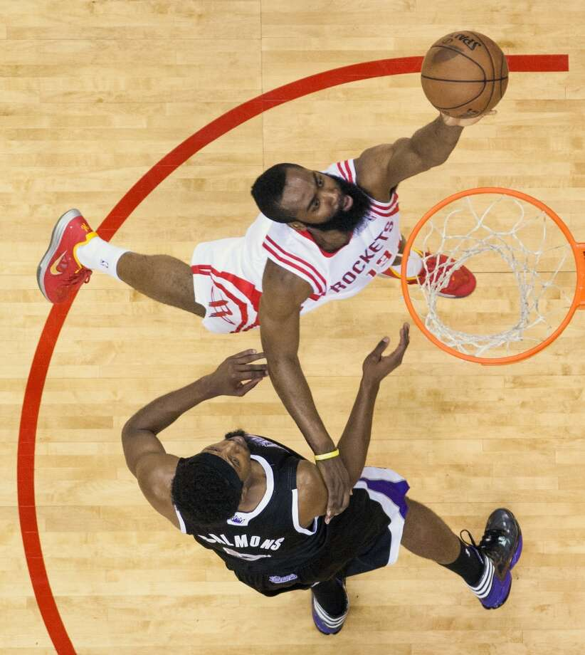 Rockets guard James Harden lays in two of his 29 points past Kings forward John Salmons. Photo: Smiley N. Pool, Houston Chronicle