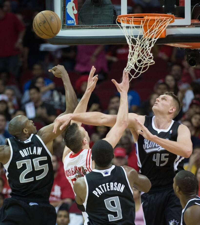 Kings small forward Travis Outlaw and center Cole Aldrich (45) defend against Rockets power forward Donatas Motiejunas.