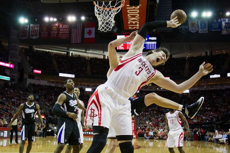 Rockets center Omer Asik is fouled by Kings center Cole Aldrich. Photo: Smiley N. Pool, Houston Chronicle