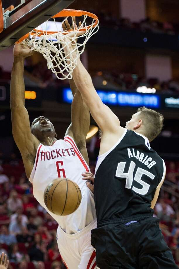 Rockets power forward Terrence Jones (6) is fouled by Kings center Cole Aldrich (45). Photo: Smiley N. Pool, Houston Chronicle