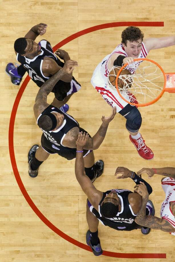 Rockets center Omer Asik dunks the ball for two of his 10 points.  He added 12 rebounds for a double double.