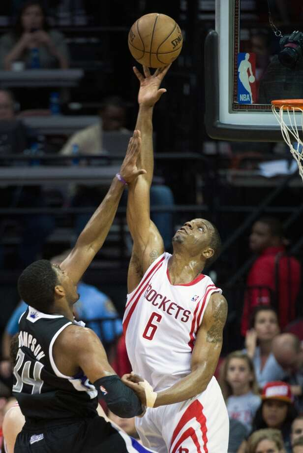 Rockets forward Terrence Jones blocks a shot by Kings forward Jason Thompson. Jones had nine points and a Rockets season-best five blocked shots.