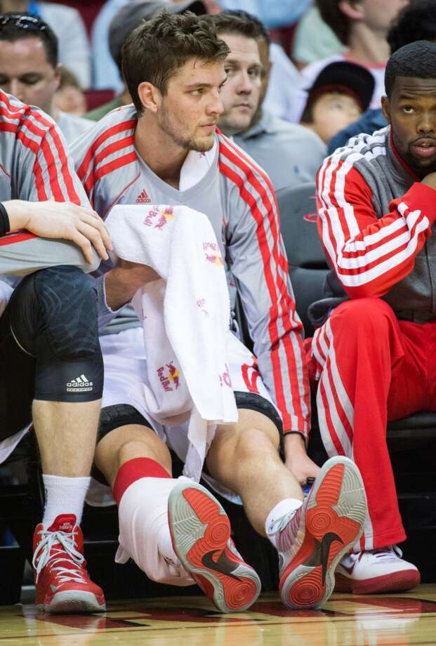 Rockets small forward Chandler Parsons sits on the bench with ice on his right calf during the first half against the Kings. Parsons returned to action after missing four games due to injury.