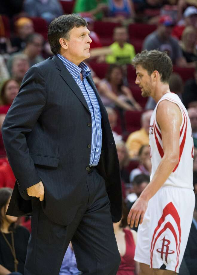 Rockets forward Chandler Parsons heads to the bench as head coach Kevin McHale calls a timeout.