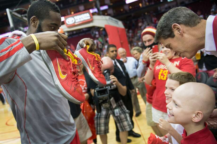 James Harden gives 9-year-old Patrick DeClaire his autographed shoes after the game. DeClaire is being treated for  stage 4 neuroblastoma at Texas Children\'s Hospital.