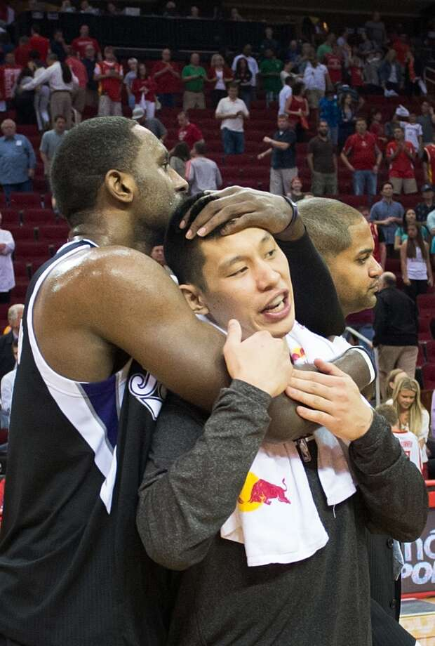 Kings power forward Patrick Patterson hugs his former teammate, Rockets point guard Jeremy Lin, after the game. nicle )
