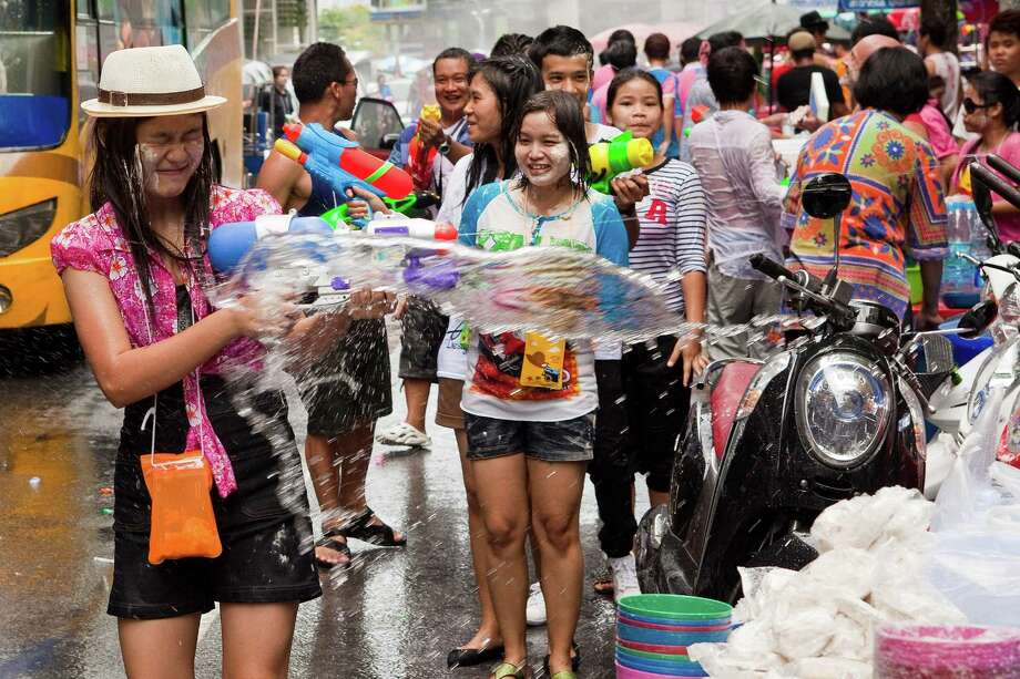BANGKOK, THAILAND - APRIL 14:  A woman reacts to being soaked by water during a community water fight as part of the Songkran water festival on April 14, 2013 in Bangkok, Thailand. The Songkran festival marks the traditional Thai New Year and is celebrated each year from April 13 to 15. The throwing of water originated as a way to pay respect to people and is meant as a symbol of cleansing and purification. (Photo by Jack Kurtz/Getty Images) Photo: Jack Kurtz, WIre / 2013 Getty Images