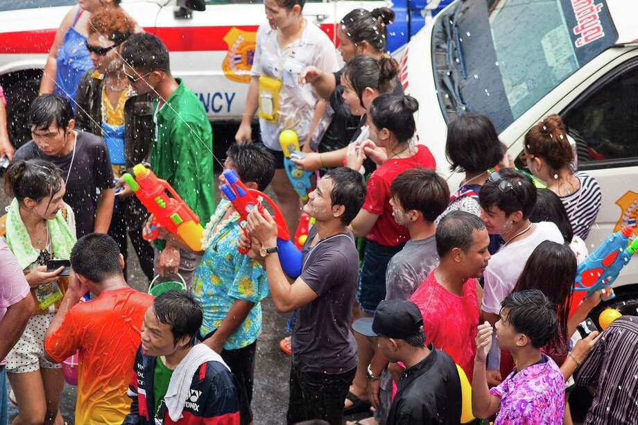 BANGKOK, THAILAND - APRIL 14:  People take part in a community water fight during the Songkran water festival on April 14, 2013 in Bangkok, Thailand. The Songkran festival marks the traditional Thai New Year and is celebrated each year from April 13 to 15. The throwing of water originated as a way to pay respect to people and is meant as a symbol of cleansing and purification. (Photo by Jack Kurtz/Getty Images) Photo: Jack Kurtz, WIre / 2013 Getty Images