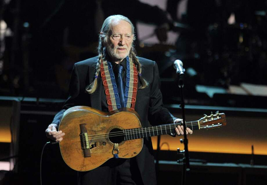 The IRS seized much of Willie Nelson's assets in 1990 claiming he hadn't paid income tax in years, owing the government $32 million. Photo: Ethan Miller, Getty Images / 2012 Getty Images