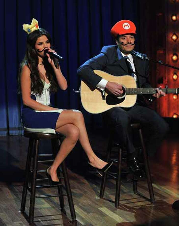 "NEW YORK, NY - MARCH 19:  Selena Gomez and Jimmy Fallon perform a ""Mario Kart Duet"" during taping of ""Late Night With Jimmy Fallon"" at Rockefeller Center on March 19, 2013 in New York City. Photo: Theo Wargo, Getty Images / 2013 Getty Images"