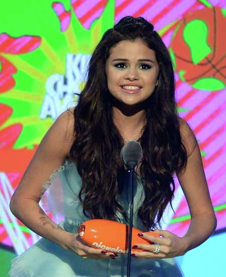 """LOS ANGELES, CA - MARCH 23:  Actress Selena Gomez, winner of Favorite Television Actress for """"Wizards of Waverly Place,"""" speaks onstage during Nickelodeon's 26th Annual Kids' Choice Awards at USC Galen Center on March 23, 2013 in Los Angeles, California. Photo: Kevork Djansezian, Getty Images For KCA / 2013 Getty Images"""