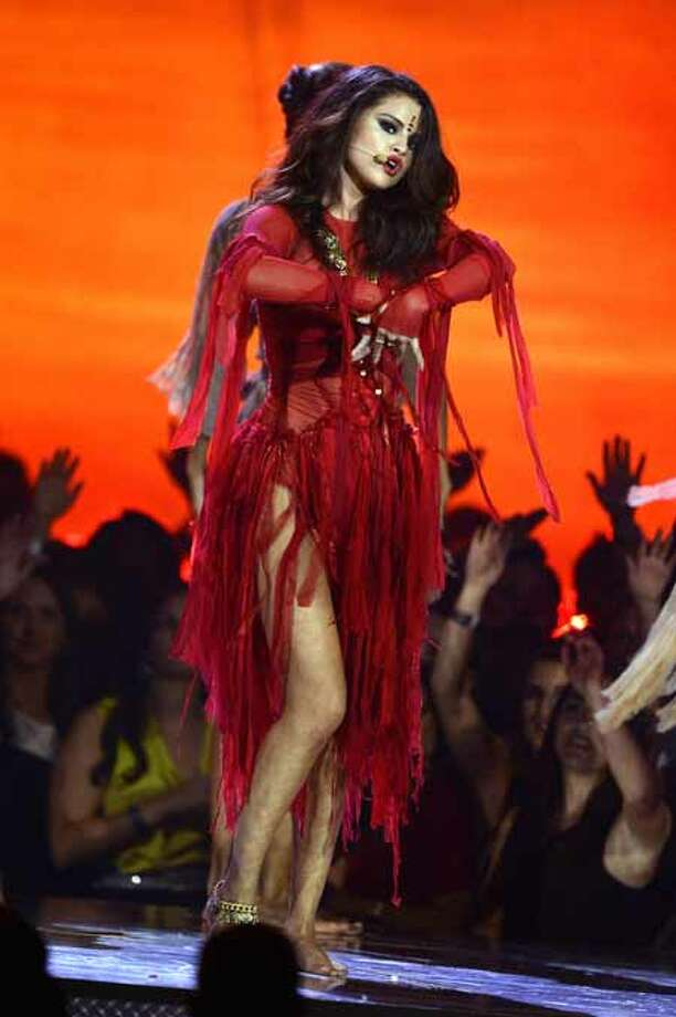 CULVER CITY, CA - APRIL 14:  Actress-singer Selena Gomez performs onstage during the 2013 MTV Movie Awards at Sony Pictures Studios on April 14, 2013 in Culver City, California. Photo: Kevork Djansezian, Getty Images / 2013 Getty Images
