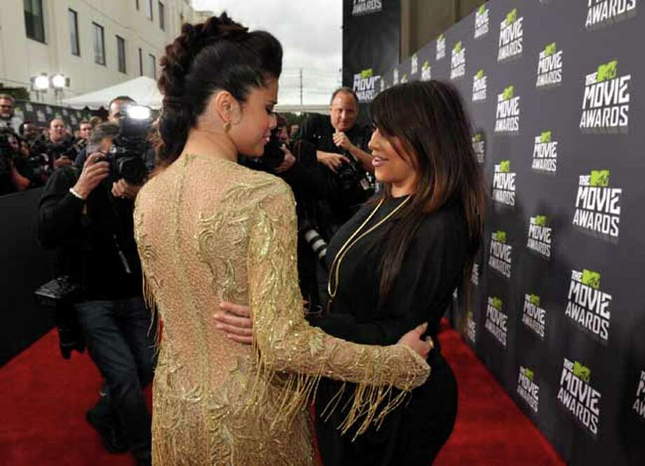 IMAGE DISTRIBUTED FOR MTV - Actress Selena Gomez and Kim Kardashian arrive at the MTV Movie Awards in Sony Pictures Studio Lot in Culver City, Calif., on Sunday April 14, 2013. (Photo by John Shearer/Invision for MTV/AP Images) Photo: John Shearer, Associated Press / Invision